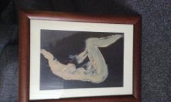 Pair of nude prints in dark wooden frames. One male and