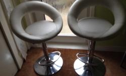 Pair of hydraulic lift bar stools looking for new home.