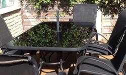 Black glass patio 143 x 92 cm with 6 high back chairs