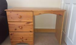 A solid pine study desk. It is in excellent condition
