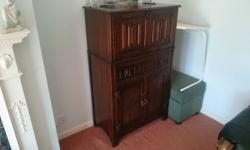 Very heavy drinks cabinet. Mirrored lit glasses unit (