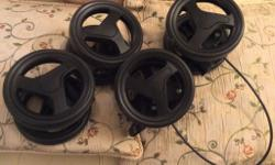 Four double sets of wheels off a Joie pushchair from