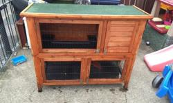 Double tier rabbit hutch Plastic lined Located concord