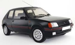 Rare peugeot 205 gti alloys. 4 good tyres. Comes with 1