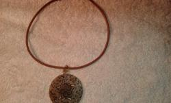 "Leather Cord is 16"" and pendant is 2 1/4"" wide, rarely"