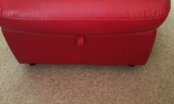 Red, leather foot stool with a storage space. From DFS