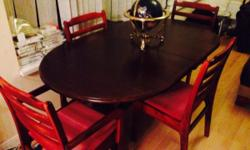 Lovely table and chairs, ideal for a family as can