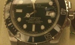Used 'Rolex Submariner' watch. Genuine, and comes with
