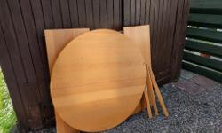round extending dining table,no chairs,a great size