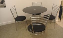Tempered black glass pedestal table with chrome leg. 4