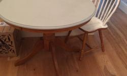 Round pine wooden dining table. Top is painted in