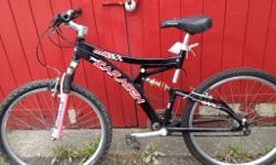 Double suspension mans mountain bike with lever brakes.