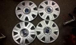 "Set of used genuine Ford 16"" wheel trims, in good"