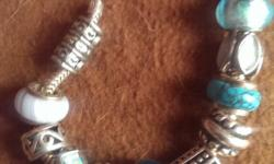 Hardly worn so excellent condition has 13 charms and