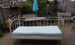 Metal framed bed with wooden slat base and single