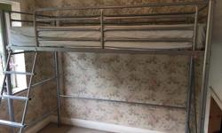 Single bed in metal with room for desk or chest of