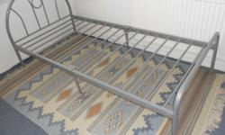 Silver grey single metal bed frame. Overall size is