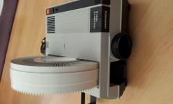 Working order slide projector with 120 slide magazine.