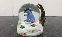 Small eeyore snow globe, has a small break on the