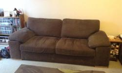 Two identical three seater sofa's, dark brown material