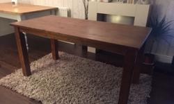 Solid dark wood dining table in immaculate condition.