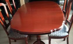 A lovely solid oak extendable dining table and 4 lovely