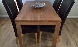 Solid oak Table with 4 Brown Leather Chairs Excellent