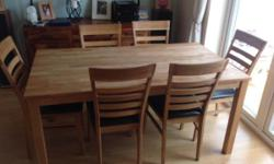 Solid Oak dining table and six matching Oak chairs.