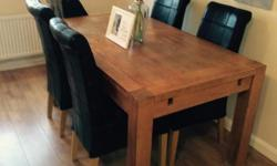 Solid oak dining table & 4 chairs, table is in good
