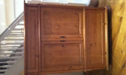 A solid pine tv cabinet. This cabinet was use to store
