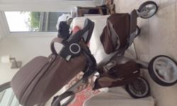 Stokke Xplory V3 buggy in brown. The pack includes: