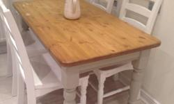 Solid pine table and chairs. Requires a light sand,