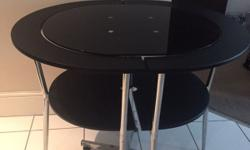 Lovely black table and two chairs. Chairs fit under
