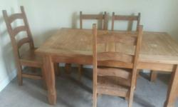Hard wood table and 5 chairs collection only call