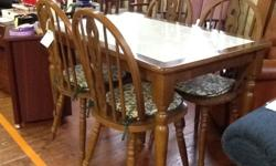 Traditional style kitchen table and four chairs.