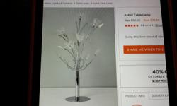 A BHS CHROME TABLE LAMP WITH GLASS FLOWERS.CONTROLLED