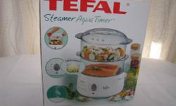 Food steamer never used still in box, clean and in good
