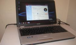 Toshiba L500 in excellent condition and working order.