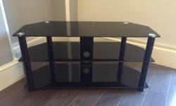 A stylish glass TV stand, with black glass its a