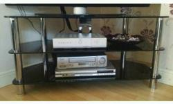 "Black glass and chrome legs up to 42"" tv stand in"