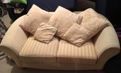 Comfortable gold type colour sofa. Main body is
