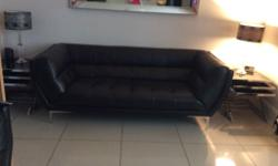 Two black leather three seaters from DFS cost 3,000
