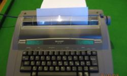 Sharp QL-110 electronic typewriter hardly used. Still