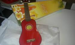 Ukulele for sale, £10.00. never used, still in box.