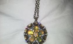 Unique looking necklace with large green and gold
