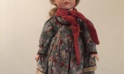 Vintage doll with victorian style clothe. In excellent