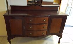 Vintage mahogany sideboard with bevelled surface, three