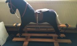 Excellent condition, rocking horse, dark brown with red
