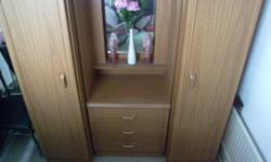 2 single sided wardrobe with 3 draws in the middle and