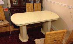 White dining table for sale. Sleek curved design with